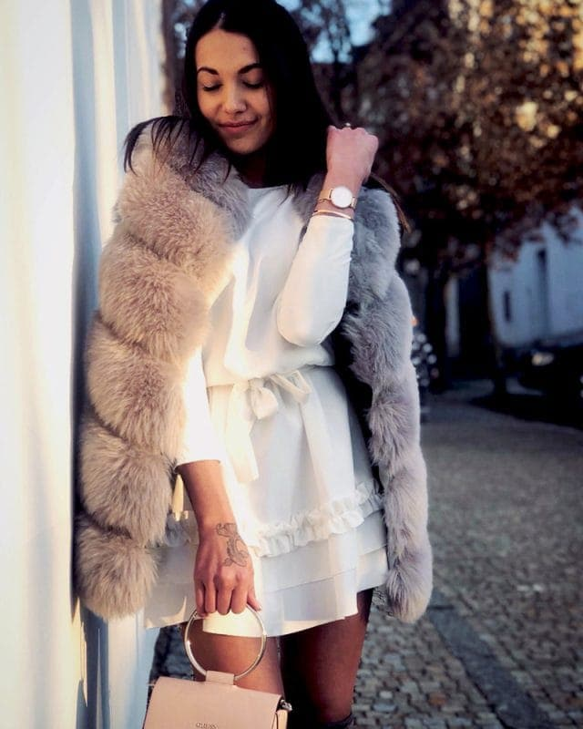 short woman faux fur vest in grey color